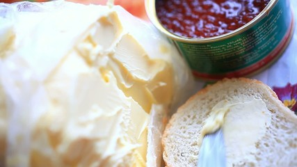 Jars with red caviar, butter and bread. Making a sandwich With