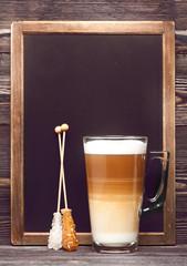 Cappuccino and menu board