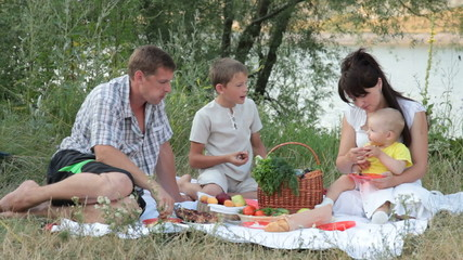 Young family with children spending weekend at picnic
