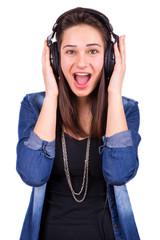 excited beautiful girl in headphones
