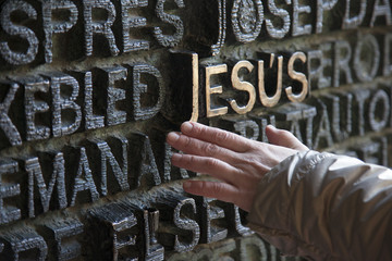 human hand and the word of Jesus