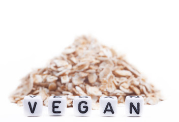 Cube Letters Show Vegan  in Front of oat flakes