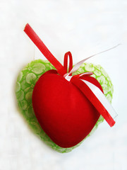Green and red valentine heart isolated on the white background