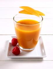 Fruity mango smoothie with raspberry