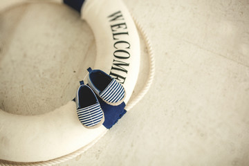 Lifebuoy and blue baby booties in stripes