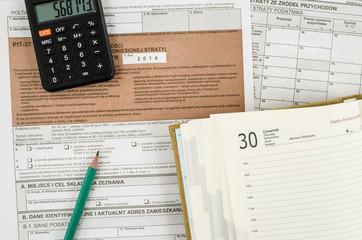 Polish tax form with pencil, calendar and calculator