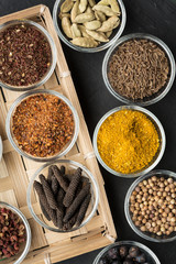 Various spices in small bowls