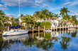 Leinwanddruck Bild - Expensive yacht and homes in Fort Lauderdale