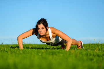 Fitness motivated woman doing push ups