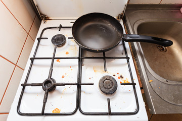 Dirty grubby gas stove in kitchen