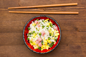 Cantonese rice on wooden table seen from above