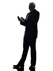 senior businessman text messaging silhouette