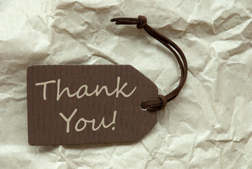 Brown Label With Thank You Paper Background