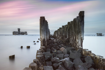 Old wooden pier and ruins of torpedo factory in Gdynia, Poland
