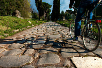 cyclist on ancient road ( Appia, Rome)
