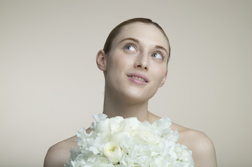 Smile of woman with a white bouquet