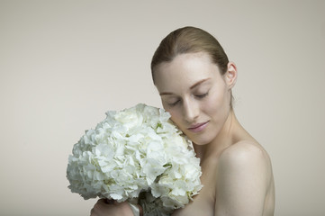 Women who are embracing a large bouquet