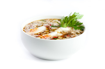 Cold vegetable soup with kvass, eggs and parsley,on a white back
