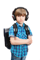 The schoolboy with backpack in bad mood stands isolated on white