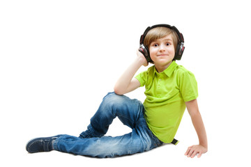The kid listening to music on the white floor