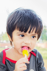 Asian Thai little boy eating ice cream
