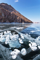 Lake Baikal in winter. Transparent ice with bubbles