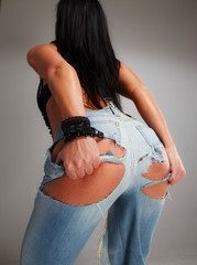 Female buttocks in jeans.