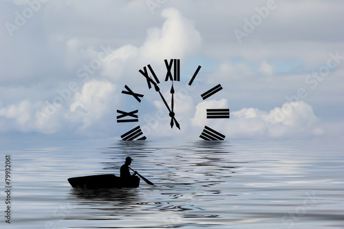 Silhouette of a boat rowing toward a clock. - 79932061