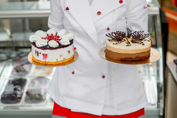 Chef holding cakes