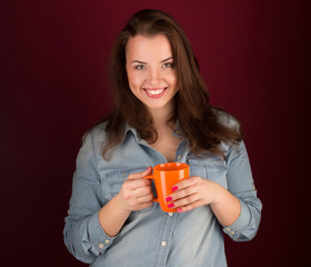 beautiful smiling girl with a cup