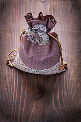 beautiful fabric bag with strings on vintage wooden board
