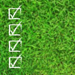 Check list over blur green grass background