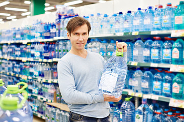 Man with big bottle drinking water