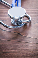 head of medical stethoscope on vintage wooden board