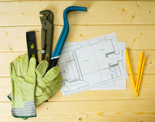 House construction. Drawings for building, wrench, gloves and