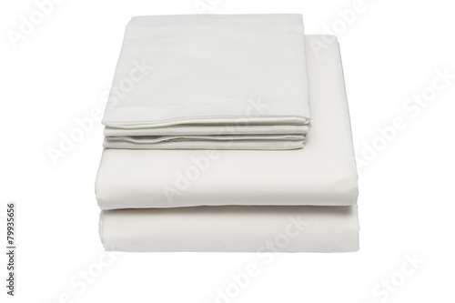 Folded bed linen on white isolated background - 79935656
