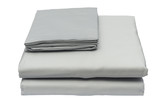 Folded bed linen on white isolated background