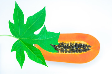 Haft cut papaya fruit and papaya leaf ,Focus on papaya leaf.