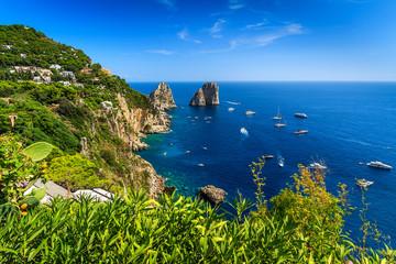 Capri island,beach and Faraglioni cliffs,Italy,Europe