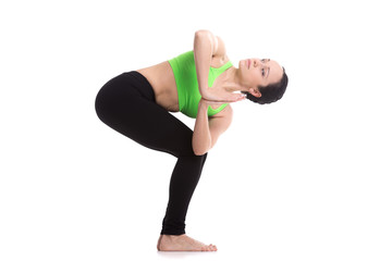 Revolved chair yoga pose