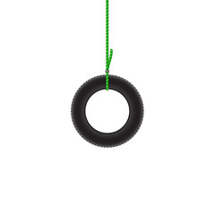 Car tire hanging on green rope