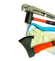 Many working tools - axe, glove and others on white background.