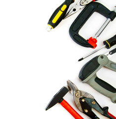 Many working tools - clamp, hammer and others on white