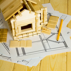 Many drawings for building, pencils and small house on wooden