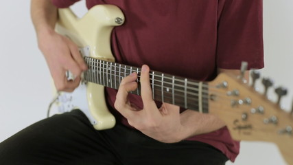 Close up of a guitar playing
