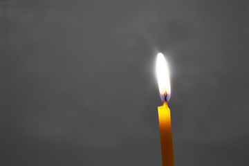 Candle on a gray background