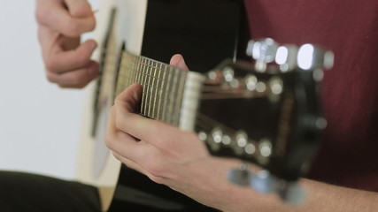 Close-up of a guitarist playing in the studio