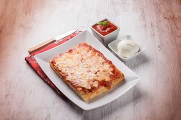 sliced pizza with buffalo mozzarella