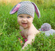 Happy baby easter bunny in green grass. - 79942886