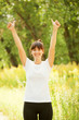 Smiling woman showing thumbs up sign